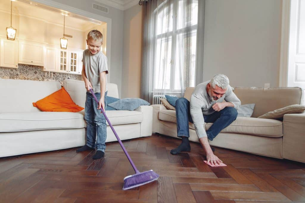 man and boy cleaning floor